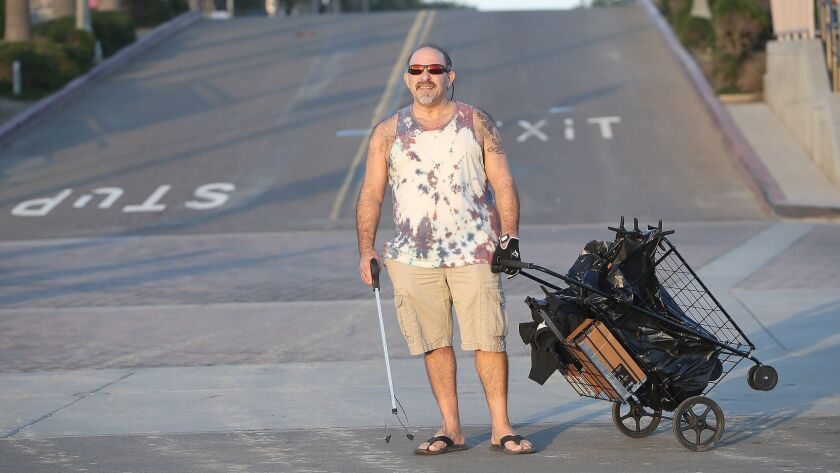 Huntington Beach resident David Hubbard is proud to collect trash while on walks on the bike path ne