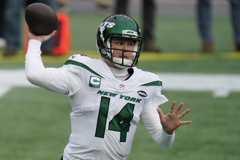 "FILE - New York Jets quarterback Sam Darnold rolls out to pass against the New England Patriots in the first half of an NFL football game in Foxborough, Mass., in this Sunday, Jan. 3, 2021, file photo. The 23-year-old quarterback was considered an untouchable player on the roster only a year ago. General manager Joe Douglas has backed off that stance, though, and it could signal a major change at the position as free agency and the NFL draft approach. ""I will answer the call if it's made,"" Douglas said Wednesday, March 3, 2021, when asked if he'd listen to offers for Darnold from other teams. (AP Photo/Charles Krupa, File)"
