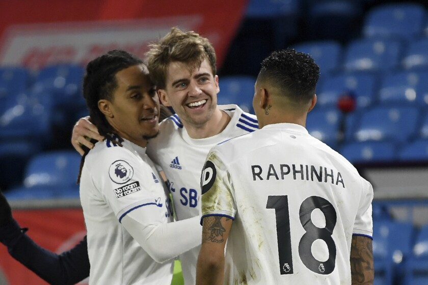 Leeds United's Patrick Bamford, center, celebrates after scoring the opening goal during the English Premier League soccer match between Leeds United and Southampton at Elland Road in Leeds, England, Tuesday, Feb. 23, 2021. (Gareth Copley/Pool via AP)