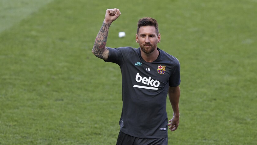 Barcelona's Lionel Messi gestures during a training session at the Luz stadium in Lisbon, Thursday Aug. 13, 2020. Barcelona will play Bayern Munich in a Champions League quarterfinals soccer match on Friday. (Rafael Marchante/Pool via AP)