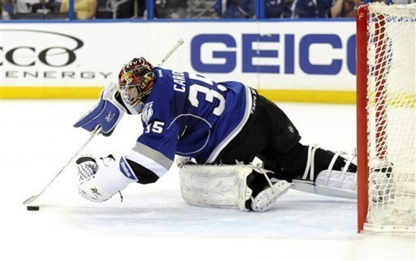Tampa Bay Lightning goalie Sebastien Caron (35) defends the goal from a shot by the Winnipeg Jets during the first period of an NHL hockey game on Saturday, March 31, 2012, in Tampa, Fla. (AP Photo/Brian Blanco)