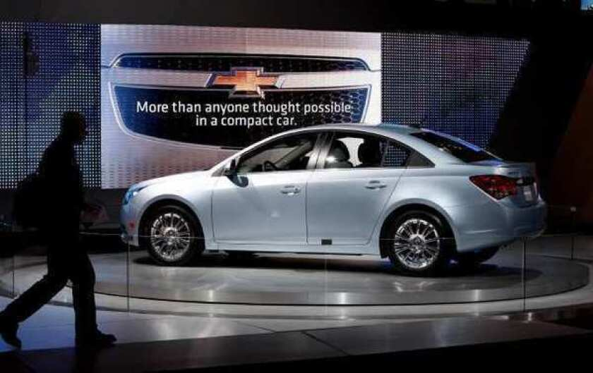 The Chevrolet Cruze on display at the 2010 Los Angeles Auto Show. Fluids dripping on the Cruze engine's shield or other hot surfaces could catch fire, prompting GM to recall the vehicles.