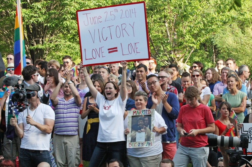 Jolene Mewing, left, and her spouse, Collen, gather with about 300 people in a downtown park in Salt Lake City to celebrate the gay marriage ruling last month. Utah is appealing the case directly to the U.S. Supreme Court.