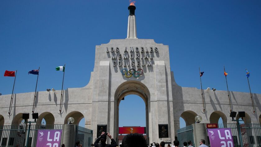 Members of the media enter the Los Angeles Memorial Coliseum, Thursday, May 11, 2017, in Los Angeles