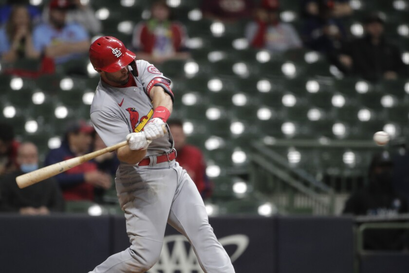 St. Louis Cardinals' Paul Goldschmidt swings on a two-run home run during the 11th inning of the team's baseball game against the Milwaukee Brewers on Tuesday, May 11, 2021, in Milwaukee. (AP Photo/Aaron Gash)