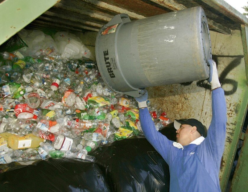 Artemio Salas handled bottles to be recycled at Regan Recycling Center in Clairemont.