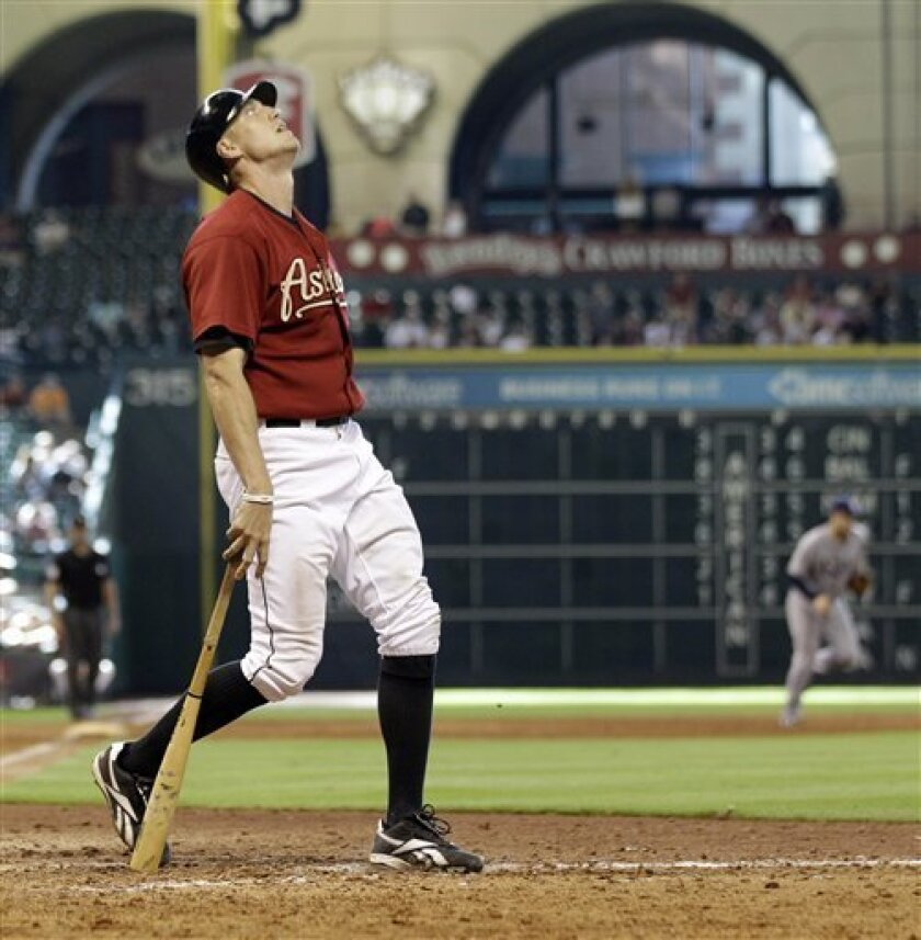Houston Astros' Hunter Pence reacts after being called out on strikes to end an interleague baseball game in the ninth inning against the Tampa Bay Rays, Sunday, June 26, 2011, in Houston. The Rays defeated the Astros 14-10. (AP Photo/David J. Phillip)