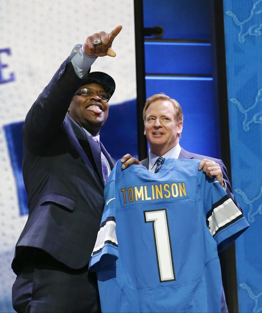 Duke offensive lineman Laken Tomlinson poses for photos with NFL commissioner Roger Goodell after being selected by the Detroit Lions as the 28th pick in the first round of the 2015 NFL Draft,  Thursday, April 30, 2015, in Chicago. (AP Photo/Charles Rex Arbogast)