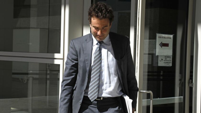 Tennis broadcaster Justin Gimelstob leaves court in Los Angeles in March. Gimelstob agreed Monday to plead no contest to a felony battery charge. A judge reduced the offense to a misdemeanor.