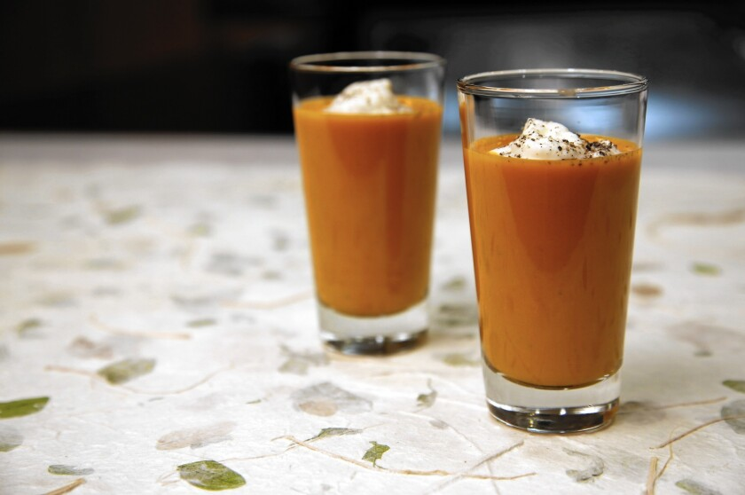 Spicy gazpacho shooter with goat cheese cream: This summery cold soup helps beat the heat.