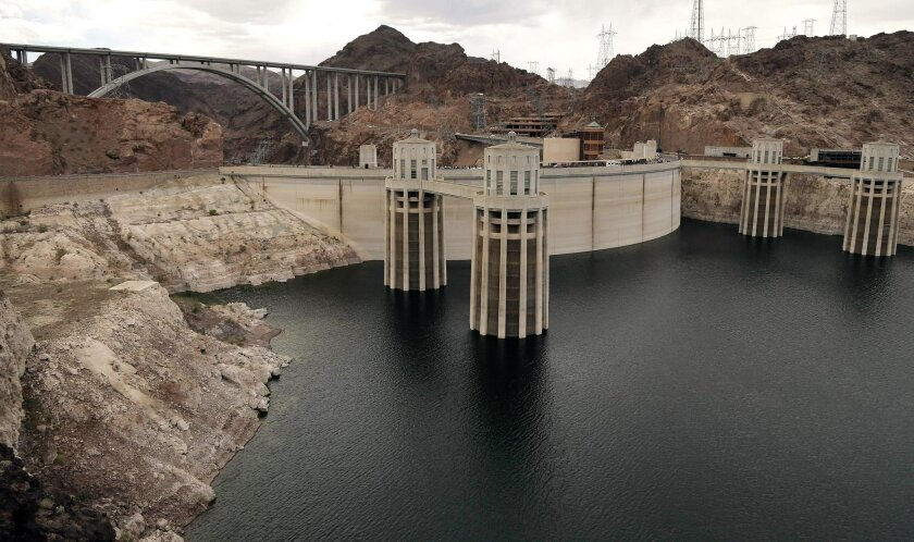 FILE - In this April 16, 2013 file photo, the high water mark for Lake Mead is seen on Hoover Dam and its spillway near Boulder City, Nev. (AP Photo/Julie Jacobson, File)