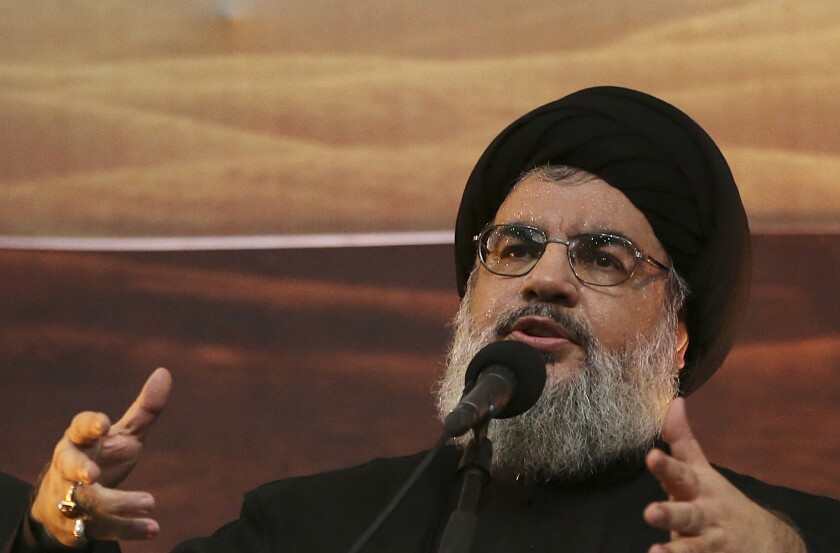 FILE - In this Nov. 3, 2014 file photo, Hezbollah leader Hassan Nasrallah addresses supporters in the southern suburb of Beirut, Lebanon. The Hezbollah leader said Tuesday, Sept. 29, 2020 they still welcome the French initiative to help Lebanon out of its crisis, but said Paris has to change its approach in dealing with local factions and not blame everyone for the failure of forming a new Cabinet. (AP Photo/Hussein Malla, File)