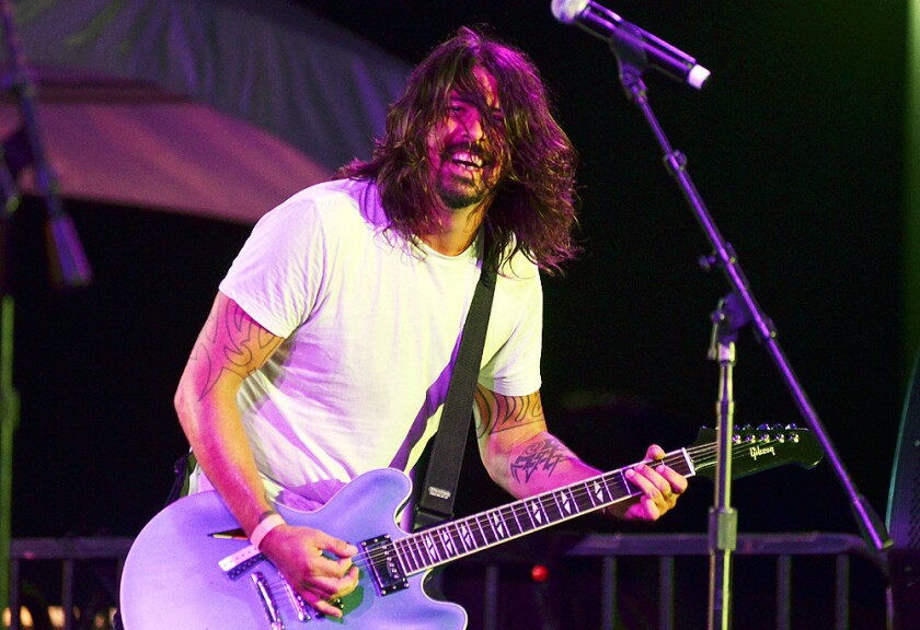 Dave Grohl, of the Grammy-winning band Foo Fighters,  performs with Chevy Metal at  Costa Mesa's 60th anniversary celebration on Saturday.