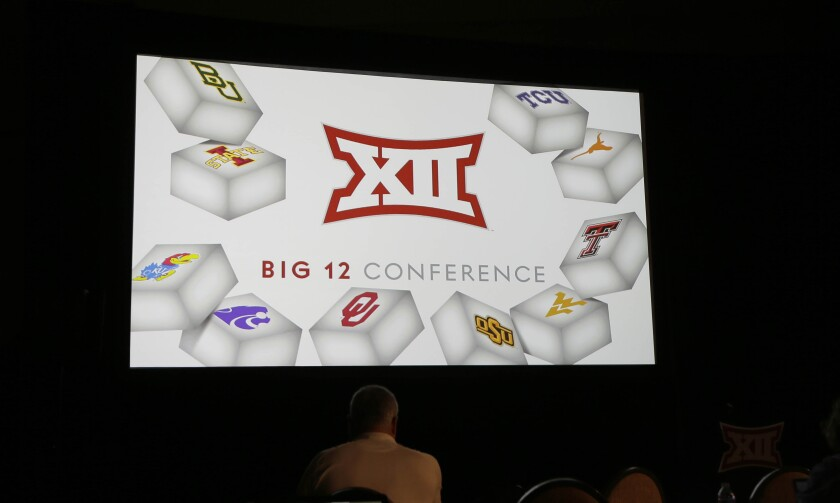 The Big 12 logo is shown during last year's Big 12 college football media days in Dallas.