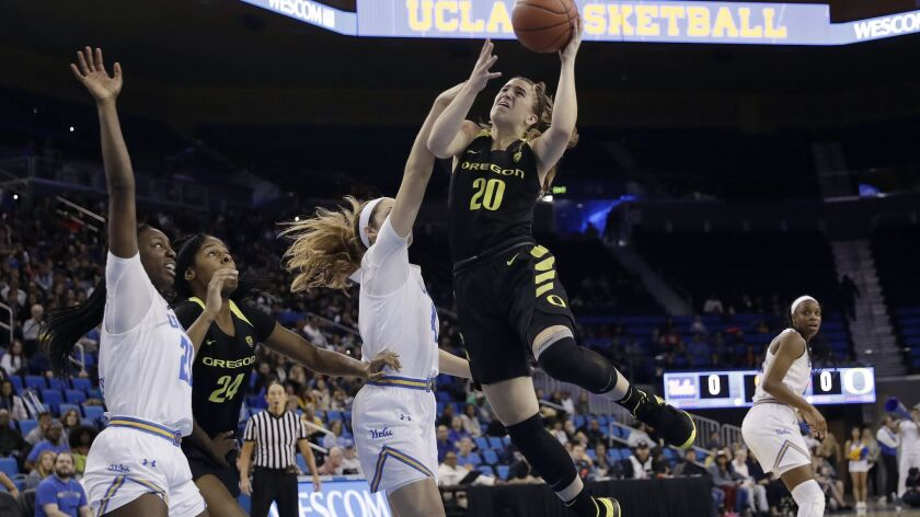 Oregon guard Sabrina Ionescu (20) shoots against UCLA during the first half on Sunday.