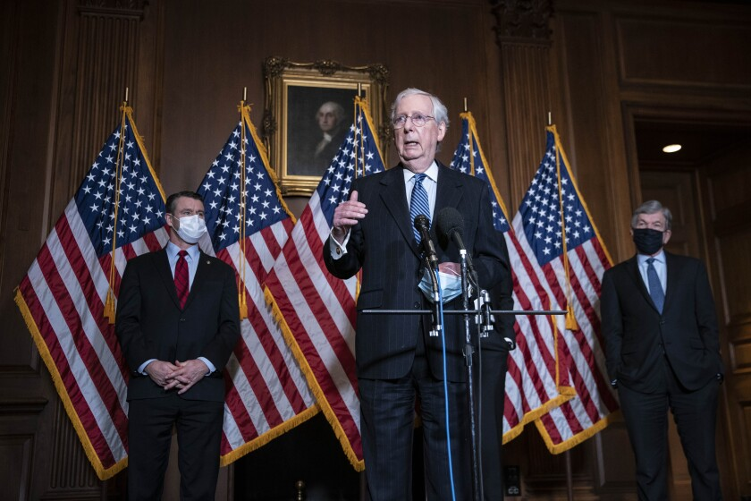 Senate Majority Leader Mitch McConnell of Kentucky, speaks during a news conference following a weekly meeting with the Senate Republican caucus, Tuesday, Dec. 8. 2020 at the Capitol in Washington. Americans waiting for Republicans in Congress to acknowledge Joe Biden as the president-elect may have to keep waiting until January as GOP leaders stick with President Donald Trump's litany of legal challenges and unproven claims of fraud. (Sarah Silbiger/Pool via AP)