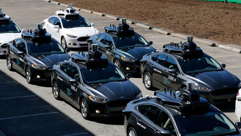 Self-driving Uber cars prepare to pick up journalists during a media preview of the technology, which is being tested on the streets of Pittsburgh.