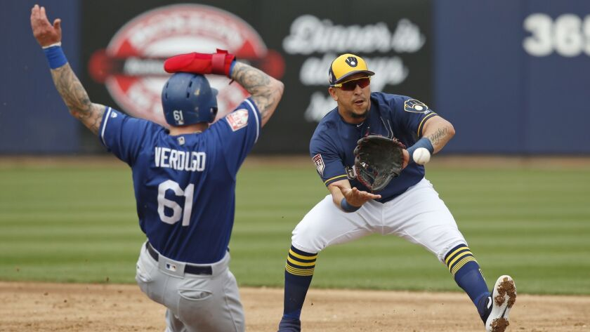 The Dodgers' Alex Verdugo is forced out at second base by Milwaukee Brewers shortstop Hernan Perez on a ball hit by Ezequiel Carrera during the second inning.