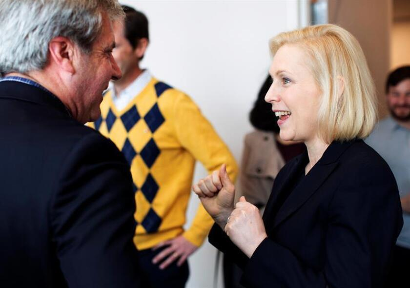Democratic presidential candidate Sen. Kirsten Gillibrand (R) is greeted by Portsmouth, New Hampshire, Mayor Jack Black (L) as she arrives to participate in a round table discussion regarding water safety during a campaign stop in Portsmouth, New Hampshire, on March 15, 2019 (Issued 17 March 2019). EFE/EPA/CJ GUNTHER