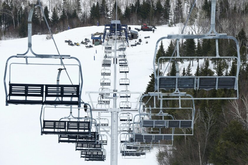 FILE - In this March 26, 2015 file photo, workers repair the King Pine chairlift at Sugarloaf Mountain Ski Resort in Carrabassett Valley, Maine, following an accident that injured several people. Sugarloaf is working to finish the installation of a new lift and to make other improvements after the second chairlift accident in a couple of years. (AP Photo/Robert F. Bukaty, files)