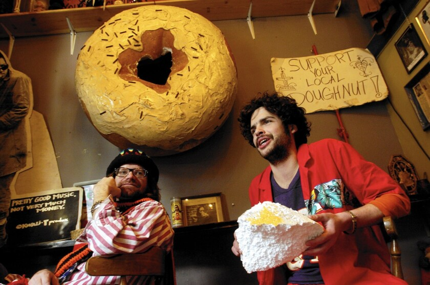 Co-owner Tres Shannon, left, and employee Jay Rubin at Portland's Voodoo Doughnuts, where the food is as offbeat as the city.
