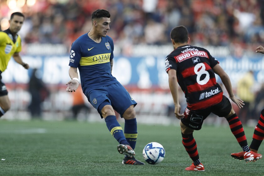 Boca Juniors' Cristian Pavon passes during a friendly soccer match against Tijuana on July 10 in  Mexico.