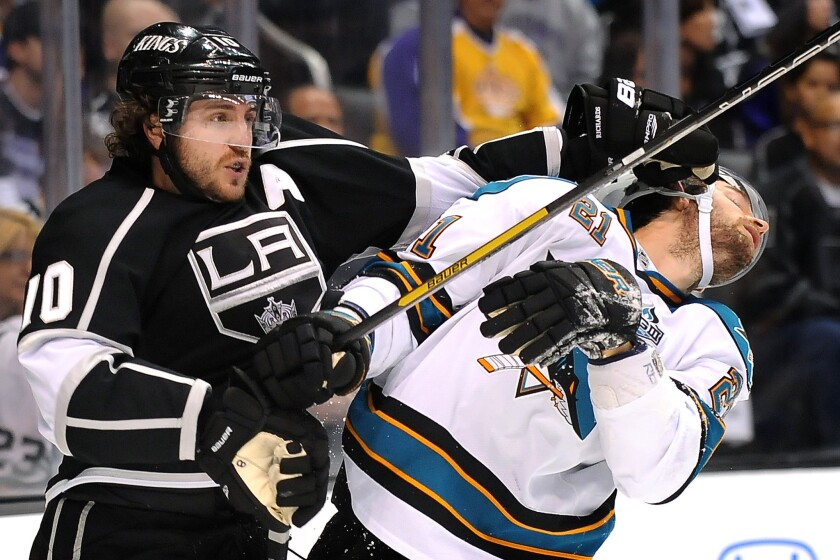Kings center Mike Richards shoves Sharks forward T.J. Galiardi in the face during the 2013 playoffs.