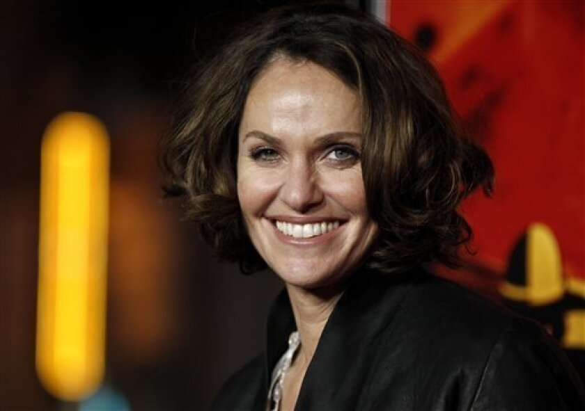 """FILE - In this Jan. 25, 2012 file photo, actress Amy Brenneman arrives at the premiere for the HBO television series """"Luck"""" in Los Angeles. Brenneman will star in the Broadway play, """"Rapture, Blister, Burn,"""" by Gina Gionfriddo. Previews begin on May 18, 2012. (AP Photo/Matt Sayles, file)"""