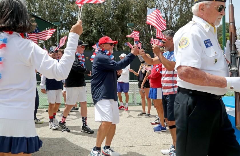 Vietnam War veteran Bob Stack, center, shares a fist bump with a fellow club member.