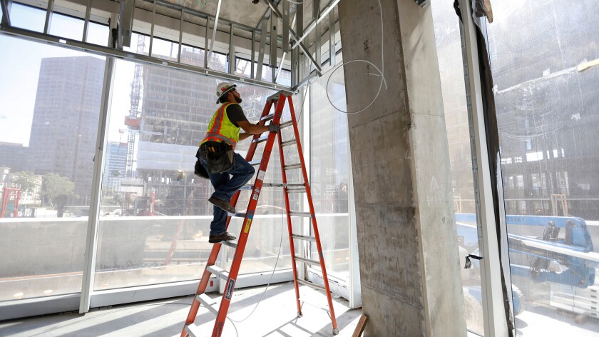 Electrician Jaime Sanchez works at a construction site in downtown Los Angeles on July 26.