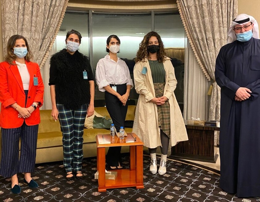 In this March 4, 2021, photo provided by the Lan Asket campaign, the founders, from left, Lina al-Qaddoumi, Najeeba Hayat, Shayma Shamo and Ascia al-Faraj, stand beside Abdulaziz al-Saqabi, one of the Kuwaiti politicians who has proposed an amendment to the penal code to define and punish sexual harassment in Kuwait City, Kuwait. (Lan Asket via AP)