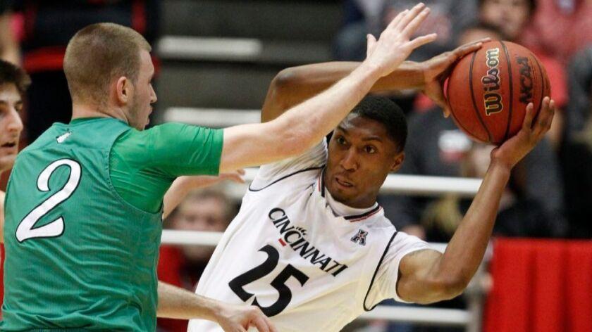 College basketball: No. 24 Cincinnati rallies for an overtime victory over Marshall. 93-91