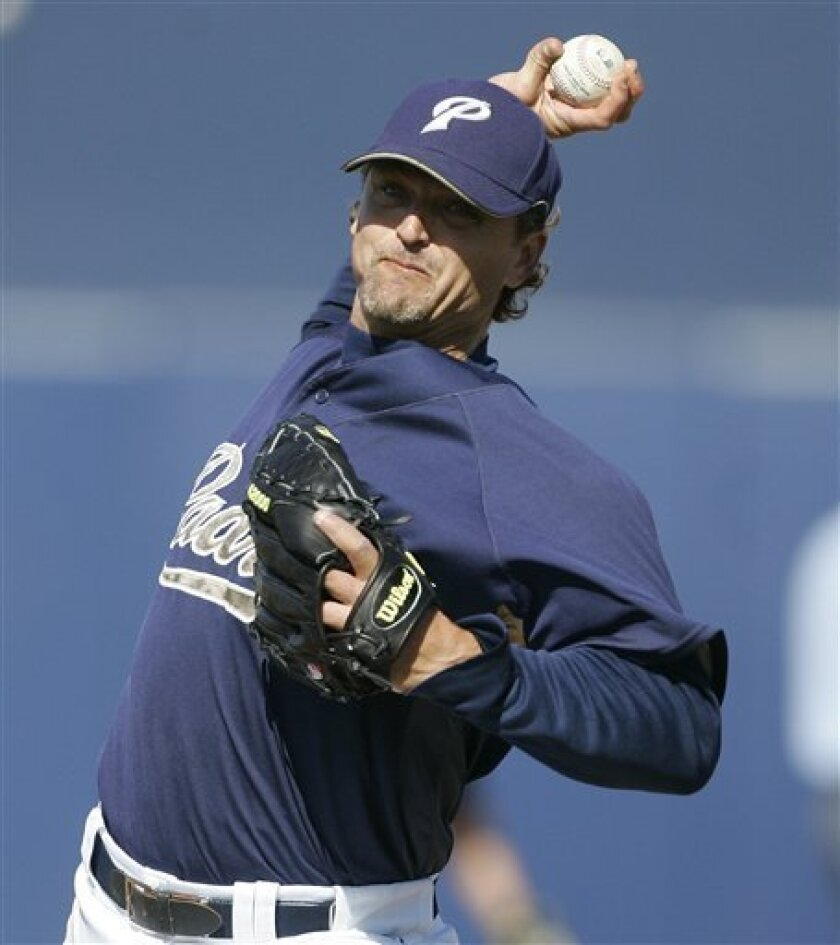 This is a March 23, 2008 file photo showing San Diego Padres' Trevor Hoffman during a spring training baseball game in Peoria, Ariz. Career saves leader Trevor Hoffman closed his deal with the Milwaukee Brewers. A person familiar with the negotiations told The Associated Press the sides reached ag