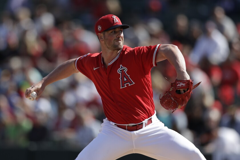 Angels relief pitcher Mike Mayers works against a Colorado Rockies batter during the third inning on Feb. 23 in Tempe, Ariz.