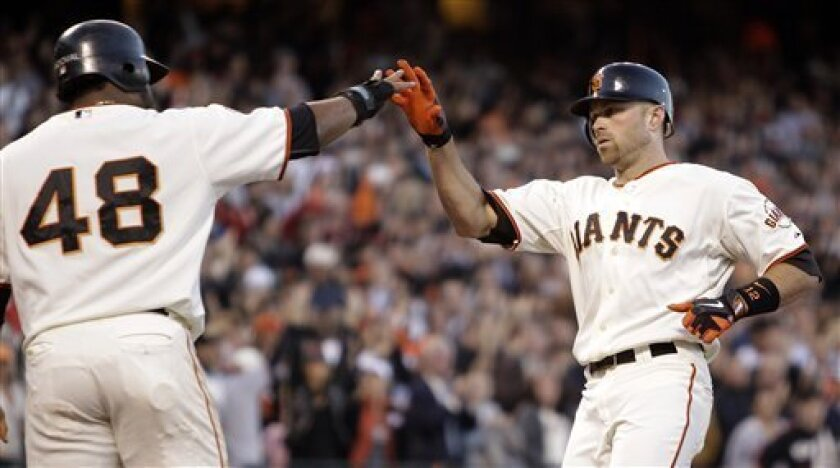 San Francisco Giants' Nate Schierholtz, right, is congratulated by Pablo Sandoval after Schierholtz hit a two-run home run off San Diego Padres' Dustin Moseley during the fourth inning of a baseball game Wednesday, July 6, 2011, in San Francisco. (AP Photo/Ben Margot)