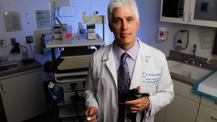 Dr. Walter Coyle, head of the Gastroenterology Department at Scripps Clinic, holds a colonoscope.