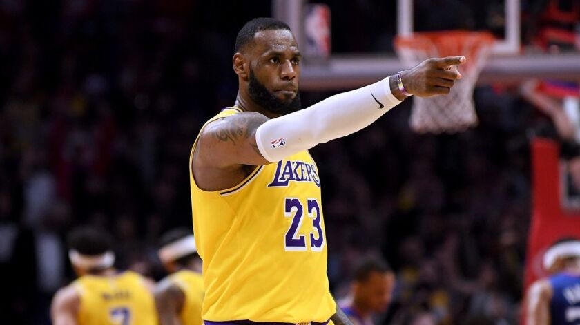Lakers star LeBron James reacts during a game against the Clippers at Staples Center on Jan. 31. The Lakers have no problem selling tickets and making money despite missing the playoffs the last six seasons.