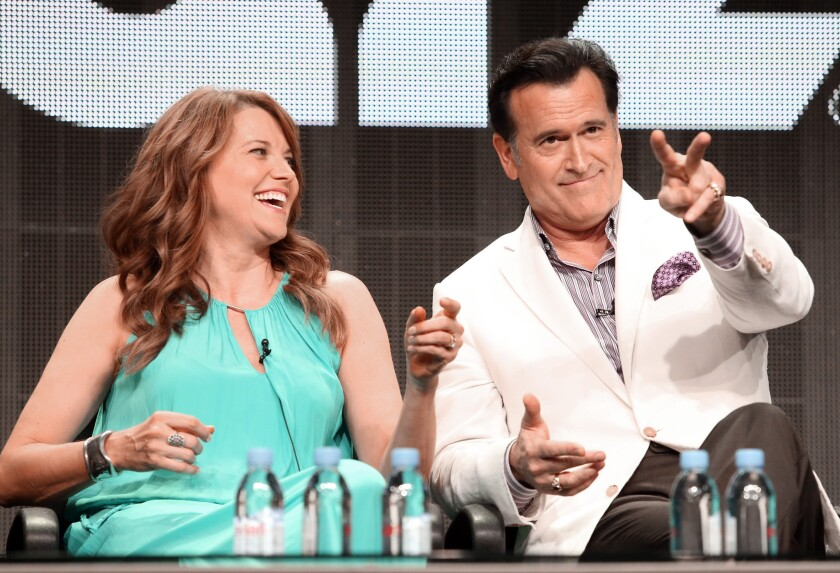 """Lucy Lawless and Bruce Campbell during the """"Ash vs. Evil Dead"""" panel at Starz's TCA presentation."""
