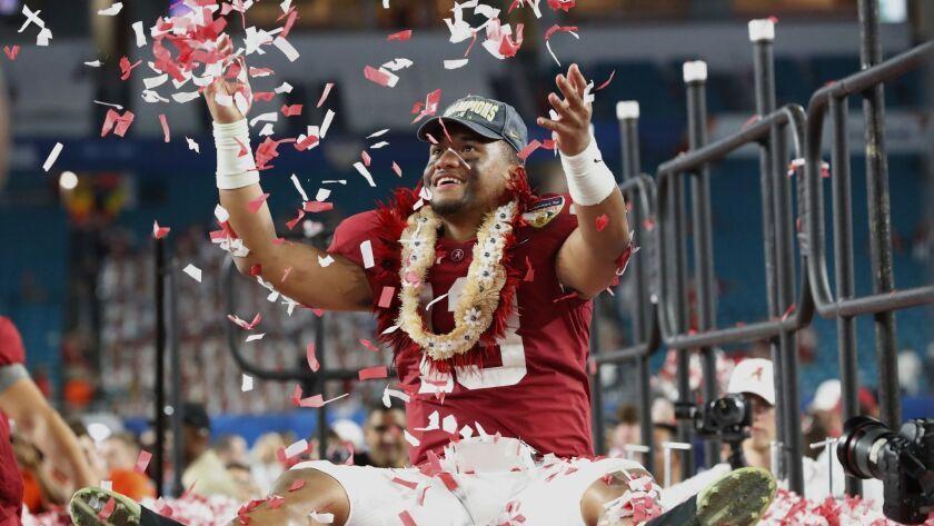 Alabama quarterback Tua Tagovailoa throws confetti into the air after beating Oklahoma to win the Orange Bowl on Dec. 30, 2018.