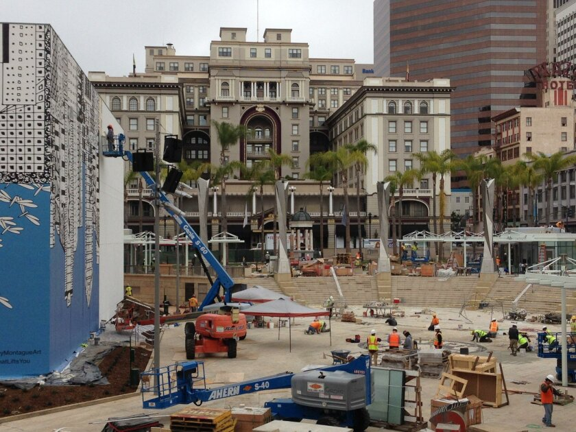 Construction workers race to finish last-minute elements at the Horton Plaza park expansion.