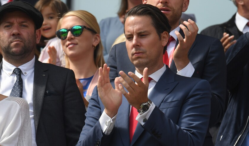 Josh Kroenke claps before a match between Arsenal FC and Burnley FC at Emirates Stadium in London on Aug. 17.