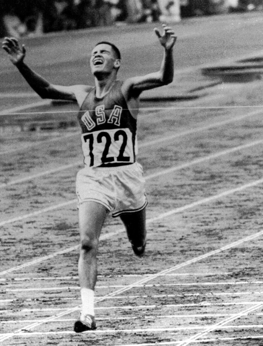 FILE - In this Oct. 14, 1964, file photo, U.S. Marine Lt. Billy Mills pulls off a stunning upset by winning the 10,000 meters Olympic race in Tokyo. Mills set an Olympic record 0f 28:24:4, and was the only American ever to win the event. (AP Photo/File)