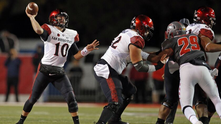 San Diego State quarterback Christian Chapman (10) throws during the second half of an NCAA college
