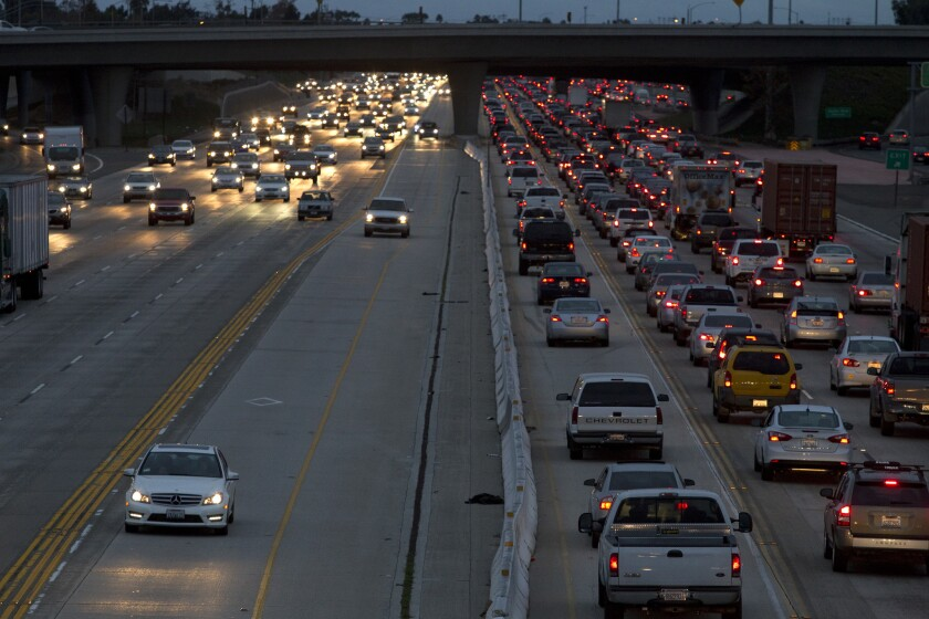 A lawmaker says the gas tax doesn't cover the cost of highway upkeep. The 405 Freeway in Costa Mesa.
