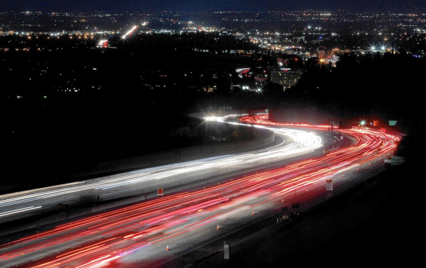 Traffic streams through the Sepulveda Pass on the 405 Freeway, which connects L.A.'s Westside to the San Fernando Valley. The northbound 405 is among the 10 most congested freeway corridors in the country.