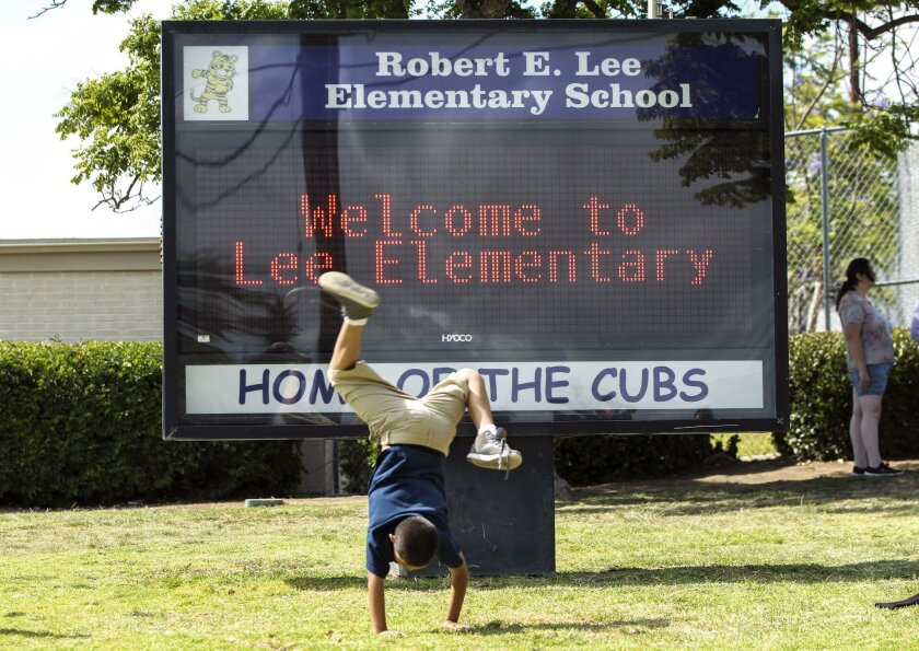 SAN DIEGO, May 24, 2016 | Third grader Juan Rodriguez Jr., 9, does a cartwheel in front of Robert E. Lee Elementary School in San Diego as they go home at the end of the school day on Tuesday. | Photo by Hayne Palmour IV/San Diego Union-Tribune/Mandatory Credit: HAYNE PALMOUR IV/SAN DIEGO UNION-TRI