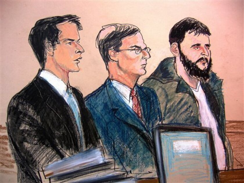 In this courtroom sketch, Assistant United States Attorney James Loonam, left, is seen with defense attorney Robert Gottlieb, center, and Gottlieb's client, defendant Adis Medunjanin, during Medunjanin's arraignment at the federal courthouse in New York City, Saturday, Jan. 9, 2010. Medunjanin pleaded not guilty to charges of receiving military training from a foreign terrorist organization and conspiracy to commit murder in a foreign country. (AP Photo/Elizabeth Williams)