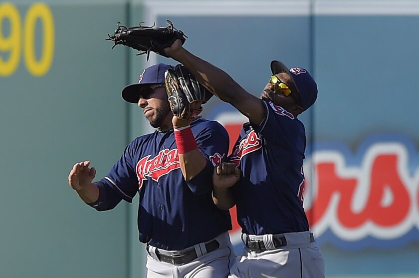 Cleveland Indians center fielder Michael Bourn, right, makes a catch on a ball hit by Los Angeles Angels' Albert Pujols as he collides with left fielder Mike Aviles during the third inning of a baseball game, Wednesday, April 30, 2014, in Anaheim, Calif. (AP Photo)