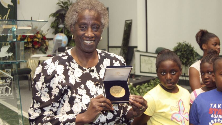 FILE - In a Tuesday, July 25, 2006 file photo, Unita Blackwell, left, the first black woman mayor in