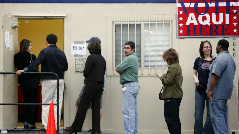 Voters wait outside a polling place held in a trailer at a grocery store parking lot on February 19, 2008 in Austin, Texas.